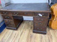 A late Victorian mahogany pedestal desk, length 132cm, depth 73cm, height 77cm
