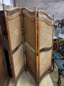 A three fold bamboo and rattan dressing screen, height 186cm