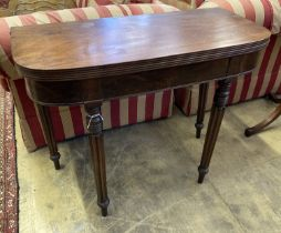 A Regency D shape mahogany folding tea table, width 93cm, depth 45cm, height 74cm