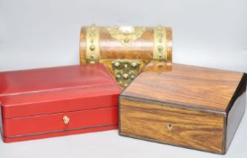 A Garrard rosewood and brass bound dome-topped box, a red leather humidor and a mahogany jewellery