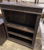 A late Victorian carved oak open bookcase, length 92cm, depth 31cm, height 115cm