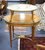 A late 19th century French satinwood, rosewood crossbanded and gilt metal mounted two tier oval