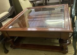 A reproduction walnut glass top square coffee table, 103cm, height 46cm