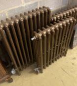 Four cast iron radiators, one vintage, three modern, largest width 64cm, height 91cm