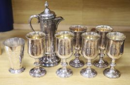 A Collis & Co Church silver plate lidded ewer, a set of six goblets from St Andrews Presbyterian