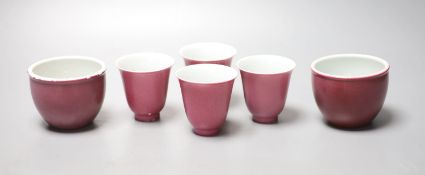 Four Chinese ruby ground cups, and a similar pair of cups, height 6cm (6)