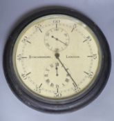 A Synchronome ebonised slave wall clock with two subsidiary dials, later glass not inset to bezel