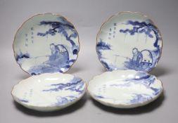 A set of four 17th century Japanese Arita blue and white plates, diameter 21cm