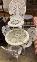 A circular Victorian style painted aluminium garden table, diameter 69cm together with a set of four