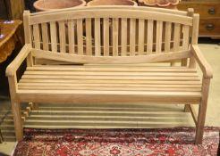 A brand new teak garden bench, length 150cm, depth 62cm, height 92cm