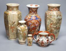 A pair of Japanese Satsuma vases, two others, an Imari vase and a two handled pot, tallest 31cm,