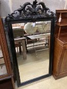 A 19th century French ebonised wall mirror, width 86cm, height 158cm