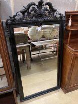 A 19th century French ebonised wall mirror, width 86cm, height 158cm