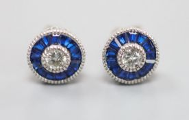 A pair of white metal (stamped China EJI) diamond and synthetic sapphire? set circular cluster
