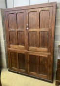 A Victorian panelled pitch pine four door cabinet, upper section marked in gilt, 'Newnham Girls