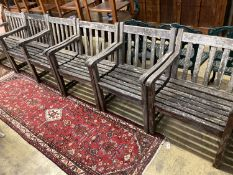 A set of six weathered teak elbow chairs, width 62cm, depth 58cm, height 85cm