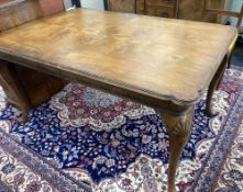 A Queen Anne revival walnut extending dining table, length 182cm extended (one spare leaf), width