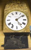 A 19th century French embossed brass wall clock, height 42cm