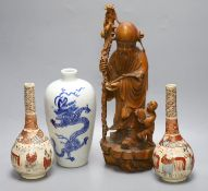 A pair of Satsuma bottle vases, a Chinese blue and white 'dragon' vase, 22cm, and a hardwood carving