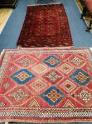 A Bokhara burgundy rug, 200 x 115cm together with a Caucasian design brick red ground rug, 164 x