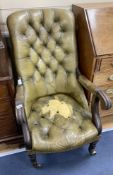 An early Victorian mahogany library armchair, upholstered in pale green leather, width 59cm, depth