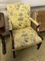"""A George III style mahogany """"Gainsborough"""" armchair, upholstered in a yellow ground fabric, width"""
