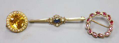 A 9ct gold sapphire and diamond bar brooch, 48mm, gross 2.9 grams, a 375 and ruby wreath brooch,