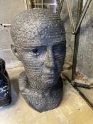 ARR Andrew Tanser, Communicate, a carved Kilkenny limestone head, width 24cm, depth 30cm,