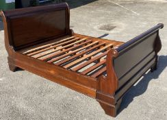A reproduction mahogany sleigh bed, width 145cm, length 205cm