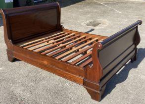 A reproduction mahogany sleigh bed, width 145cm, length 205cm