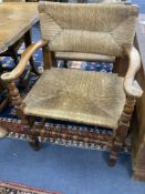 A set of eight turned beech dining chairs with rush seats and backs (two with arms)