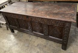 An 18th century carved panelled oak coffer, length 149cm, depth 62cm, height 67cm