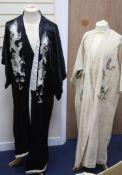 A Japanese black silk satin kimono embroidered with a white silk dragon, 133cm long and a cream silk