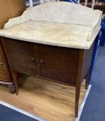 An Edwardian marble top bow front washstand, width 77cm, depth 48cm, height 94cm