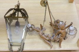 A metal framed ceiling lantern and a three branch cherub and lustre hung ceiling pendant (2)