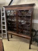 An early 20th century Chippendale revival glazed mahogany bookcase, width 120cm, depth 35cm,