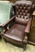 An early Victorian burgundy leather library chair, width 68cm, depth 80cm, height 98cm