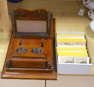 A large Victorian walnut stereoscopic card viewer with slides, Football at Eton etc, length 58cm