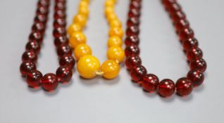 Two faux amber necklaces, 148cm and 44cm.