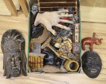 A quantity of mixed ethnographica carvings including tribal masks, bellows etc