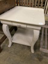 A rectangular French style painted two tier occasional table, width 71cm, depth 59cm, height 62cm