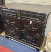 A Jacobean oak cupboard, fitted with a pair of doors, width 111cm, depth 60cm, height 102cm