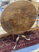 A mid 18th century mahogany tripod table with birdcage platform, diameter 76cm, height 70cm