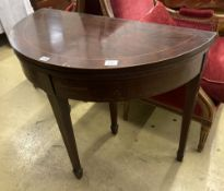 A George III style inlaid mahogany 'D' shaped folding card table, width 92cm, depth 46cm, height