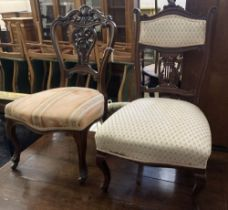 A pair of Victorian walnut dining chairs, on cabriole legs