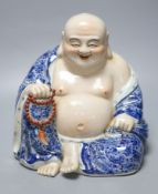 A Chinese porcelain figure of Budai, height 26cm