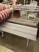 A wrought iron slatted folding garden bench, length 105cm, depth 52cm, height 86cm together with a