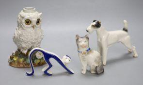 A Victorian porcelain 'owl' oil lamp base, lacking mount, an Austrian porcelain terrier and two
