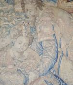 A 17th century Brussels tapestry fragment, depicting two figures, 26 x 19.25in.CONDITION: Somewhat