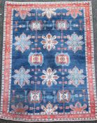 An Iranian Loribaft blue ground rug, with field of floral motifs and three row border, 225 x